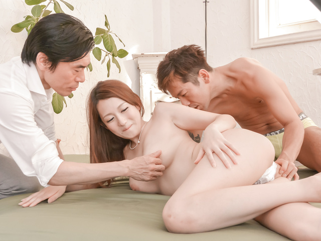 Hot Asian girl receiving cumshot from two hungry cocks